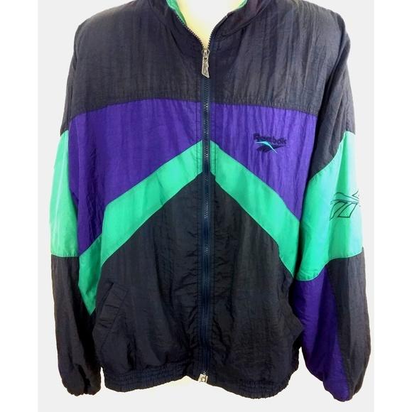 5d1fe9efe1157 Vintage 90's Reebok Spell Out Windbreaker